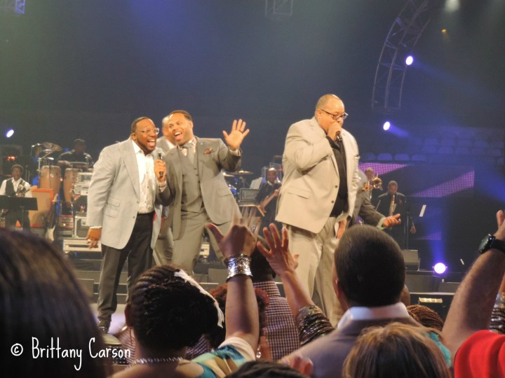 """Marvin Sapp hops on stage to join the United Tenors in singing """"Blessed in the City"""" by Fred Hammond."""