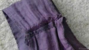 fabric shredding at the seams of shopping bag handle