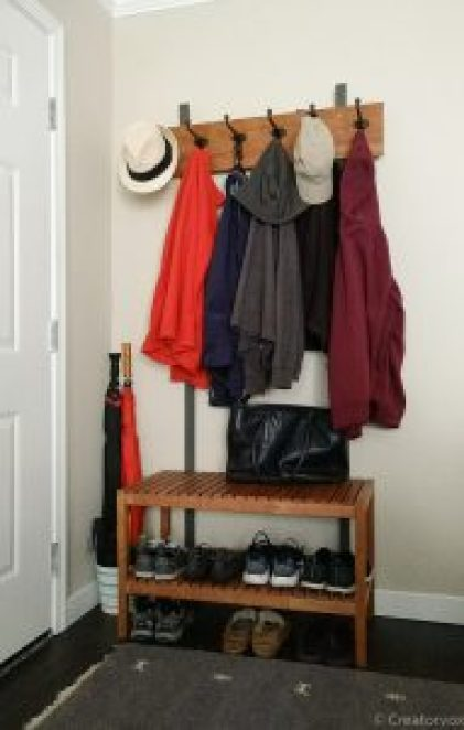 entryway organizer with coats, shoes, and hats