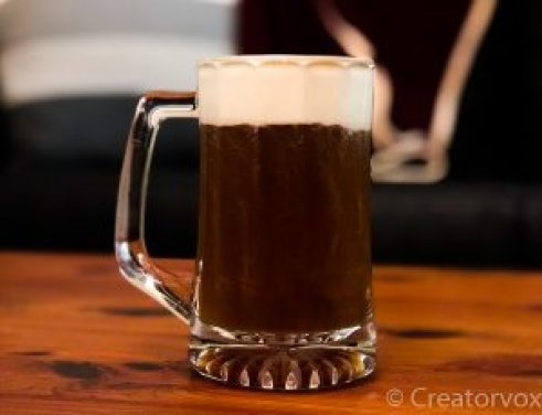 glass mug of Irish coffee with the whipped cream floating on top