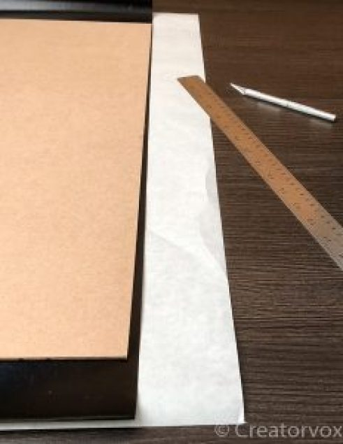 vinyl contact paper overhanging MDF, steel ruler, x-acto knife