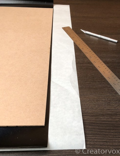 vinyl contact paper overhanging MDF, steel ruler, x-acto knife