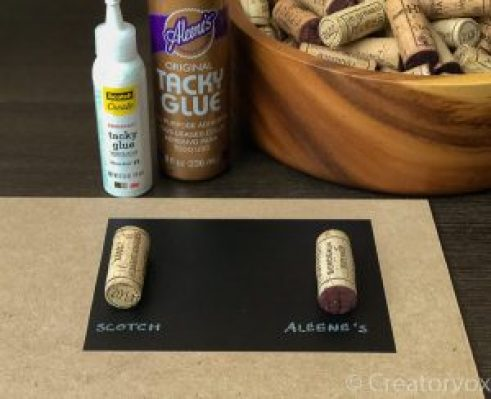 two corks stuck with different glues to a piece of vinyl contact paper
