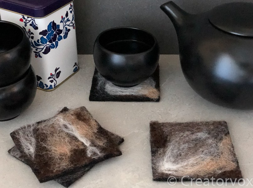 set of four felted coasters with abstract designs