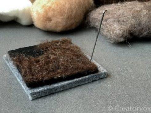 use a single needle to felt the edges of a coaster