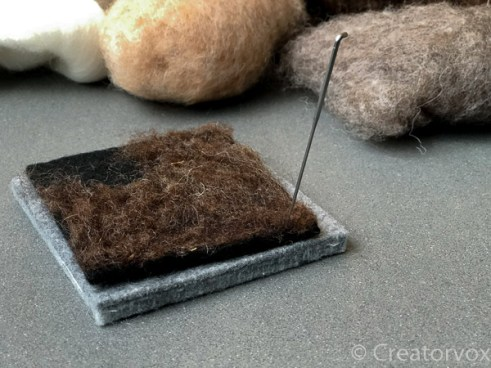 use a single needle to felt the edges of a coaster