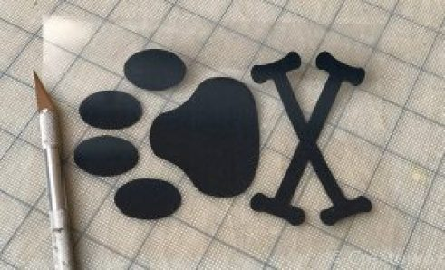 vinyl transfer of a dog paw-print and crossbones