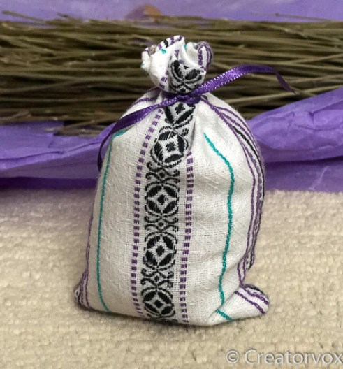 lavender sachet with gathered top and purple ribbon