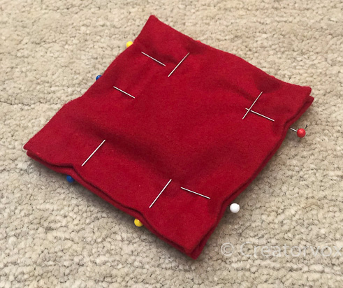 red flannel pocket hand warmers pinned