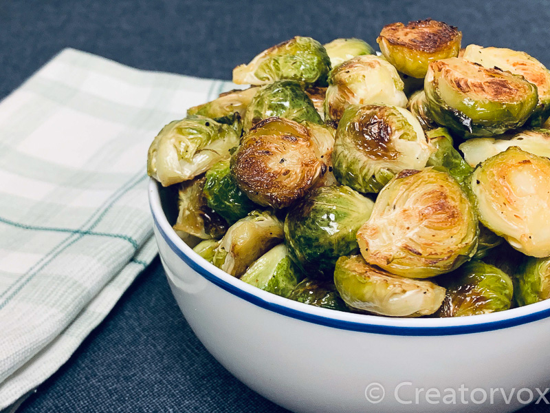 roasted Brussels sprouts in a white serving bowl