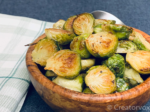 roasted Brussels sprouts ready for serving in a wooden bowl
