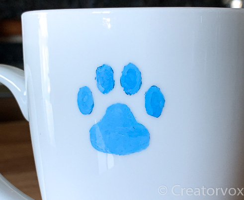 oil based marker in stencil tracing on mug