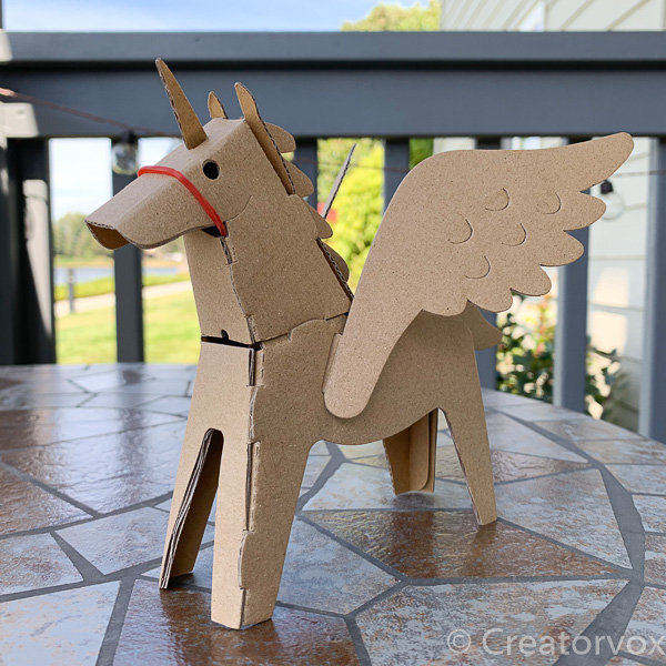 cardboard unicorn with wings from Maker Faire