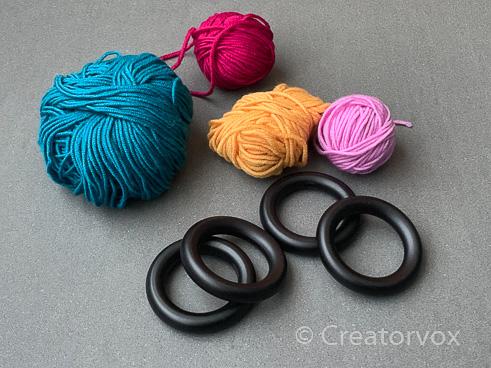 yarn and curtain rings to make upcycled napkin rings