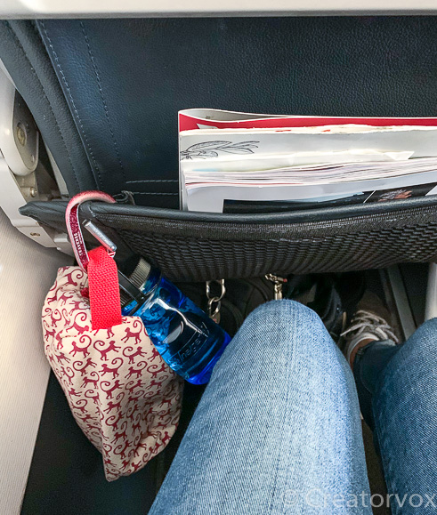 in flight organizer clipped to the seat back pocket