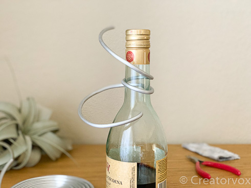 use a bottle to make smooth curves in armature wire for an artistic air plant holder