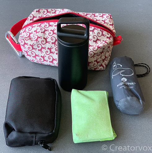water bottle pouches and neck pillow that go into an in flight organizer