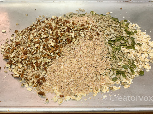 dry ingredients for homemade granola on a baking tray