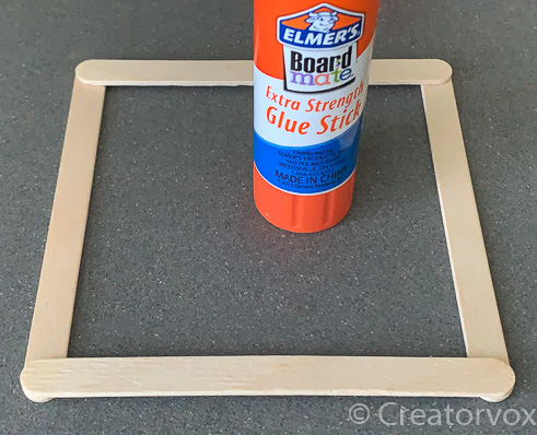 apply glue stick to top and bottom of shade frame