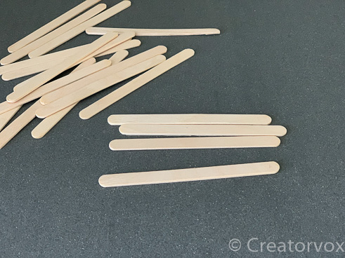 find four flat craft sticks for the DIY nightlight frame
