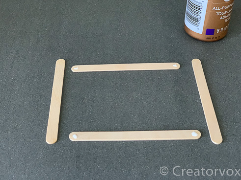glue four craft sticks together to make a square nightlight shade