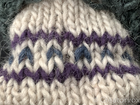 pull the colors together when weaving in ends to avoid stepping