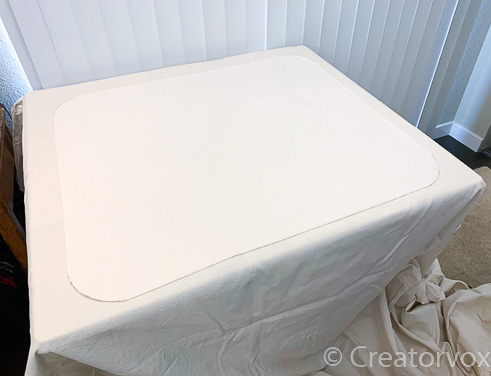 table covered in drop cloth ready for fabric painting