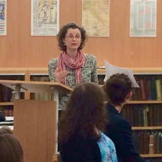 Dr Liz Edwards discussing material from the Curious Travellers project.