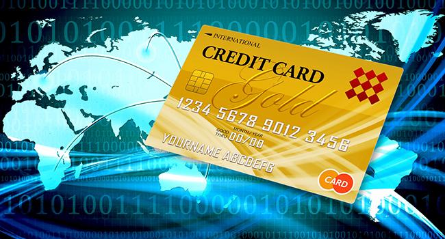 世界地図の上にクレジットカード
