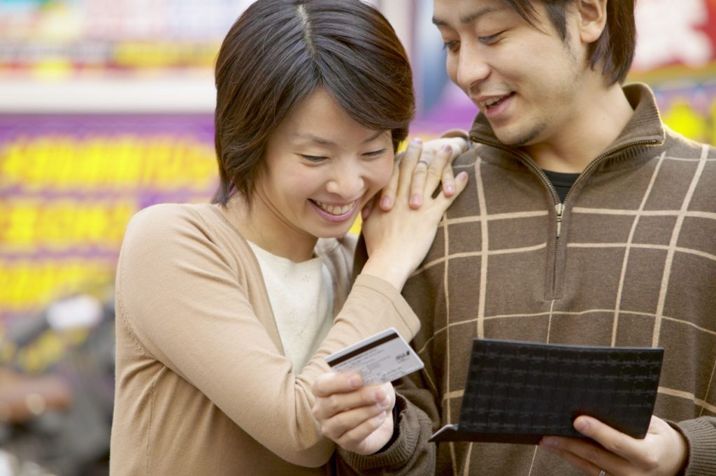 Couple Using a MasterCard Credit Card.