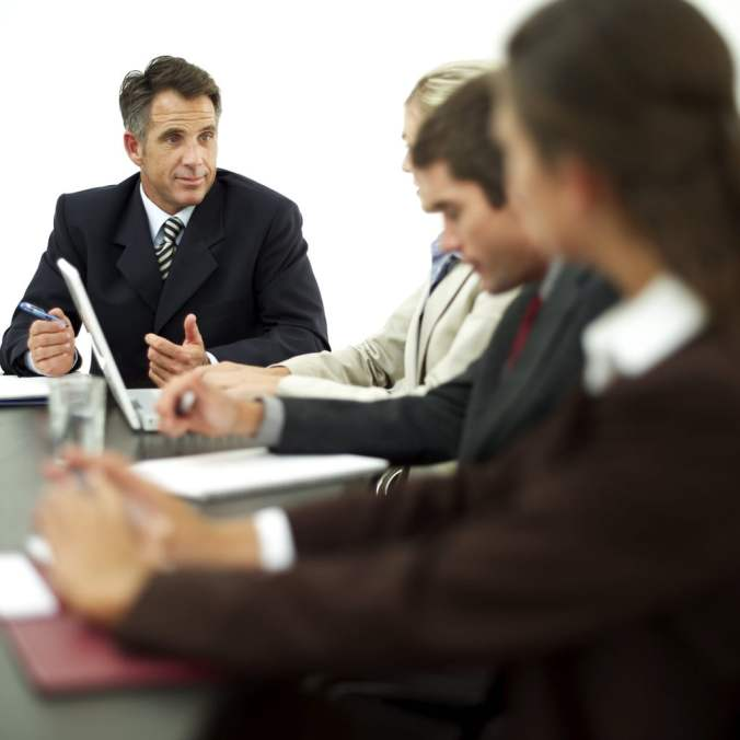 Businessman Conducting Meeting with Staff