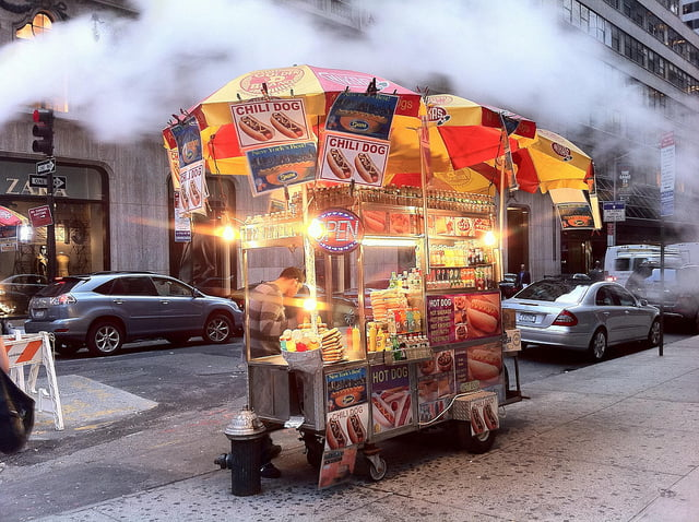 Hot Dog Vendor on City Street