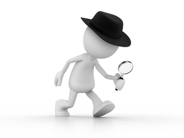 Clipart Investigator Figure with Magnifying Glass