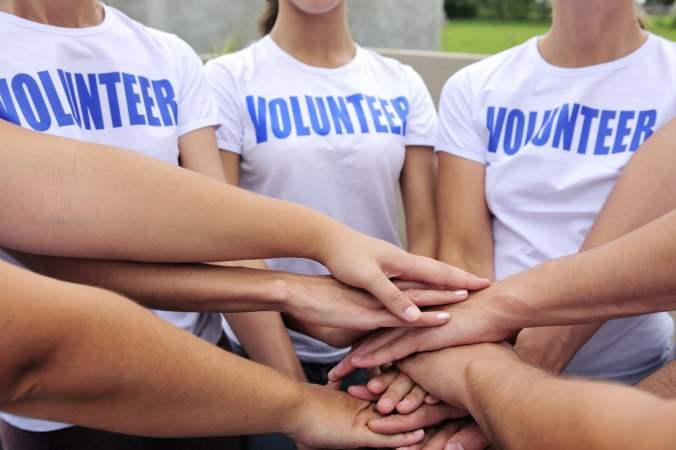 Volunteer Group Stacking Hands