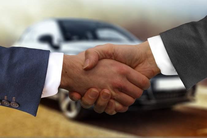 Handshake with Car Behind