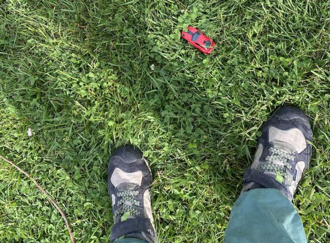 Shoes and Toy Car in Grass