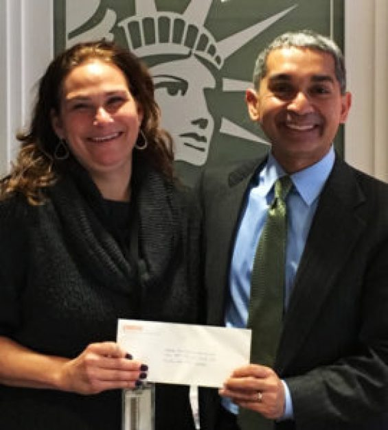 Photo of political director of CREDO presenting grant check to president of NARAL