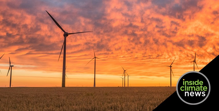 Photo of a windmill farm at sunset