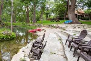 stone steps next to creek with kayaks