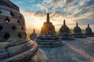 As the sun sets, Borobudur Temple in bathed in beautiful golden light. Central Java, Indonesia