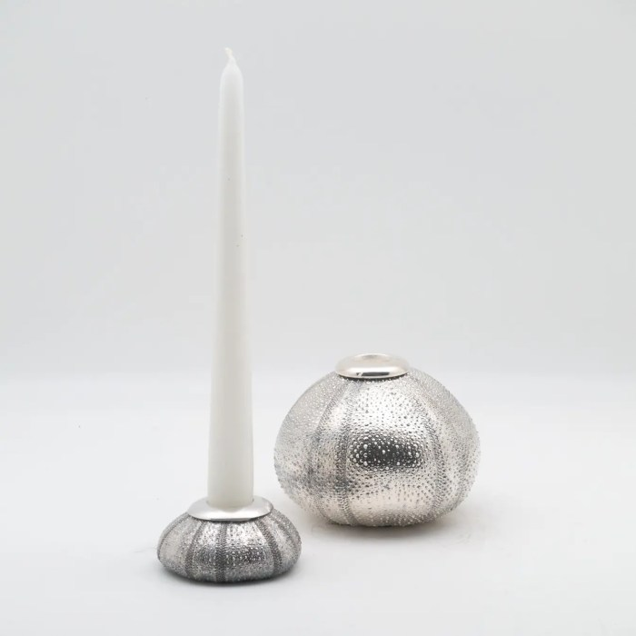 small and large silver candlestick holders