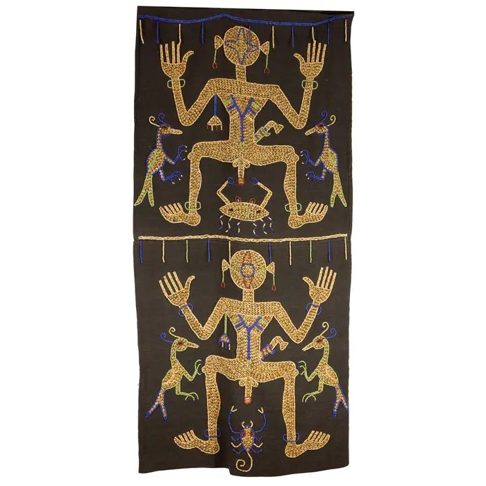 Shell Embroidered Fabric Wall Hanging with figures of men with birds and scorpions.