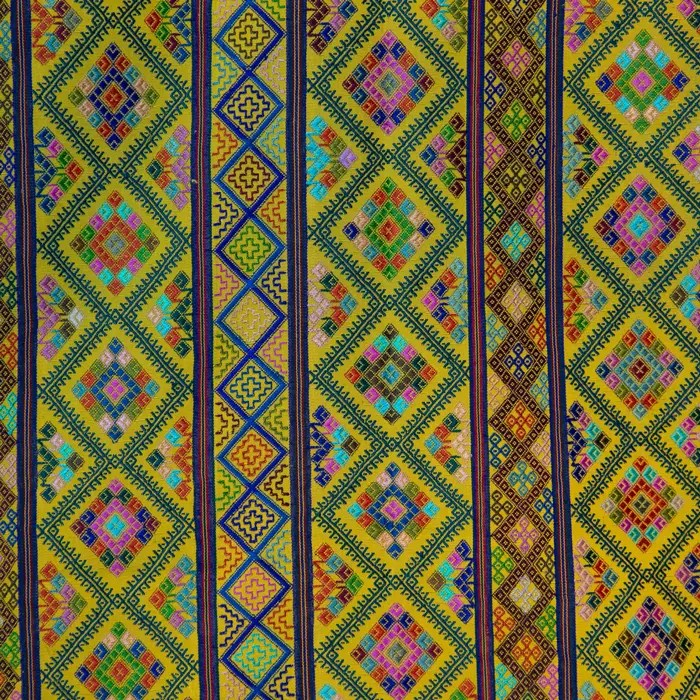 closeup of Large Colorful Yellow Textile with multicolor geometric designs