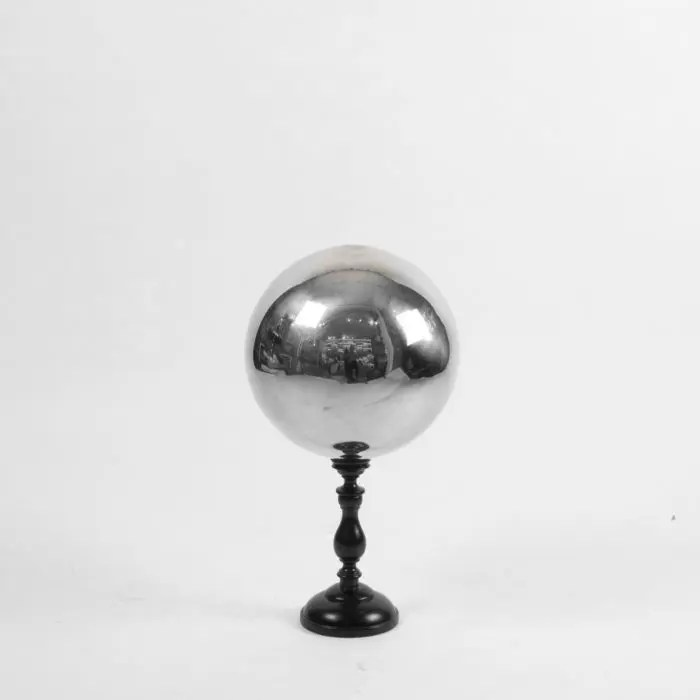 Butler's ball mounted on a turned wooden base