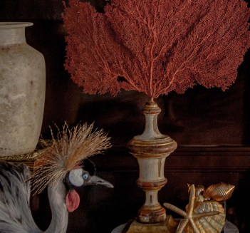 African Crown Crane sitting along with an Alabaster Vase and Orange Sea Fan Mounted on Antique Gilded Base