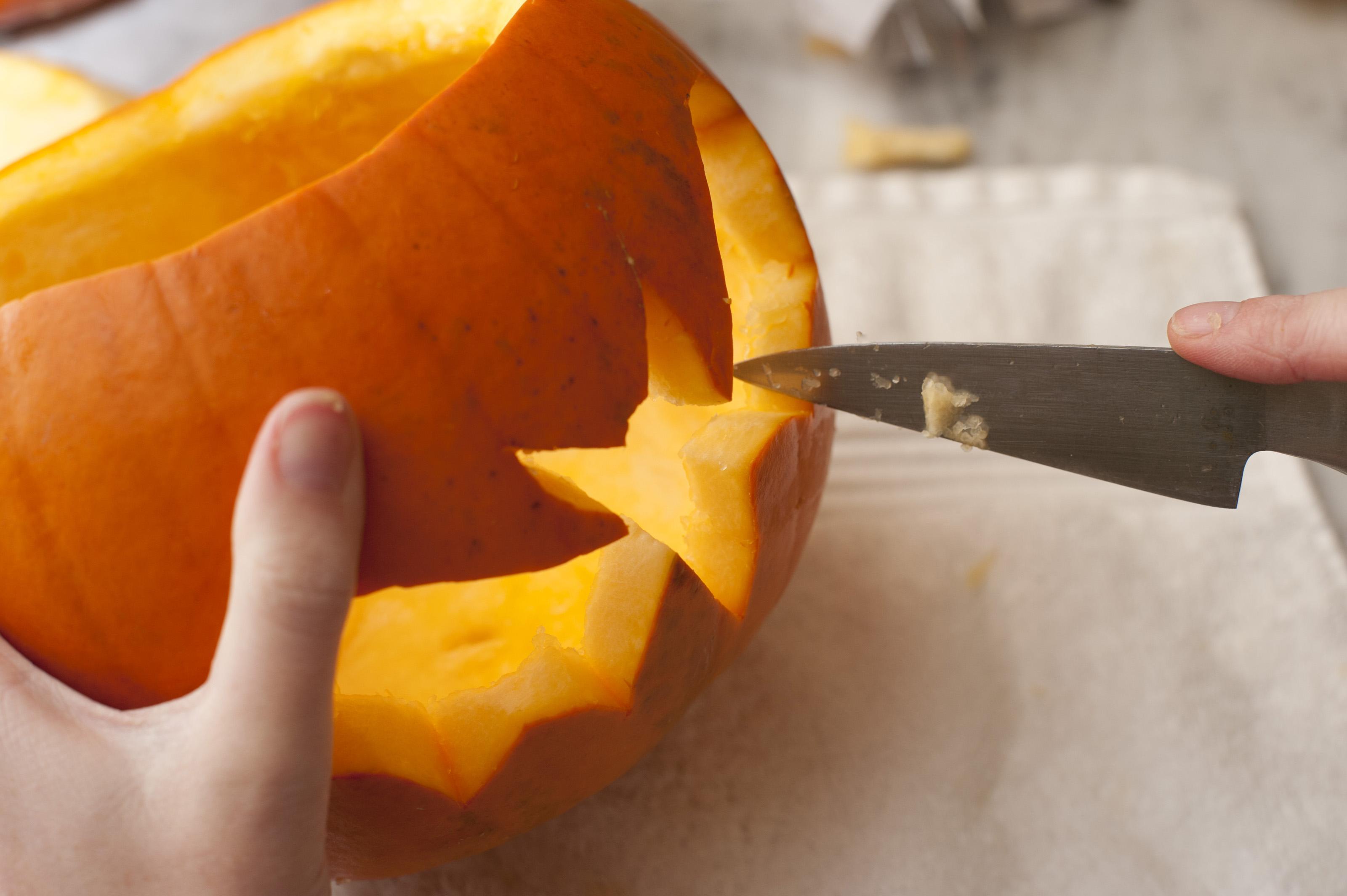 Image Of Man Carving A Pumpkin Lantern For Halloween