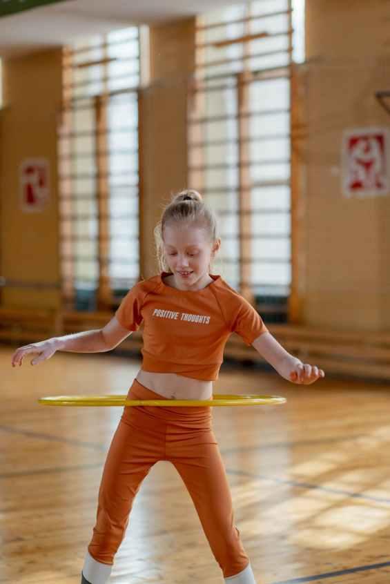 a girl using a hula hoop