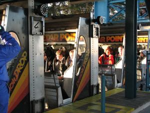 Cedar_Point_Demon_Drop_cars_in_station_(4070477873)
