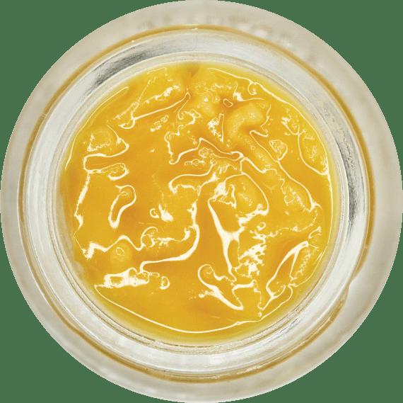 Orange-Yellow cake frosting/badder like consistency, looks wet with terpenes. Sitting in jar.