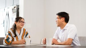 couple enjoys coffee in their home